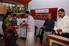 MLA hands over documents sponsoring the Educational Expenses of 3 Children for 3 years to the family of Vicitm of Crime