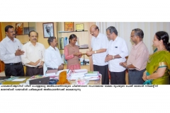 MCL MD Mr.K.Padmnakumar hands over cheque for rs.1 lakh Ms.Alfonsa, Victim of Acid Burns