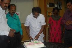 Sri.A.K.balan is cutting the cake
